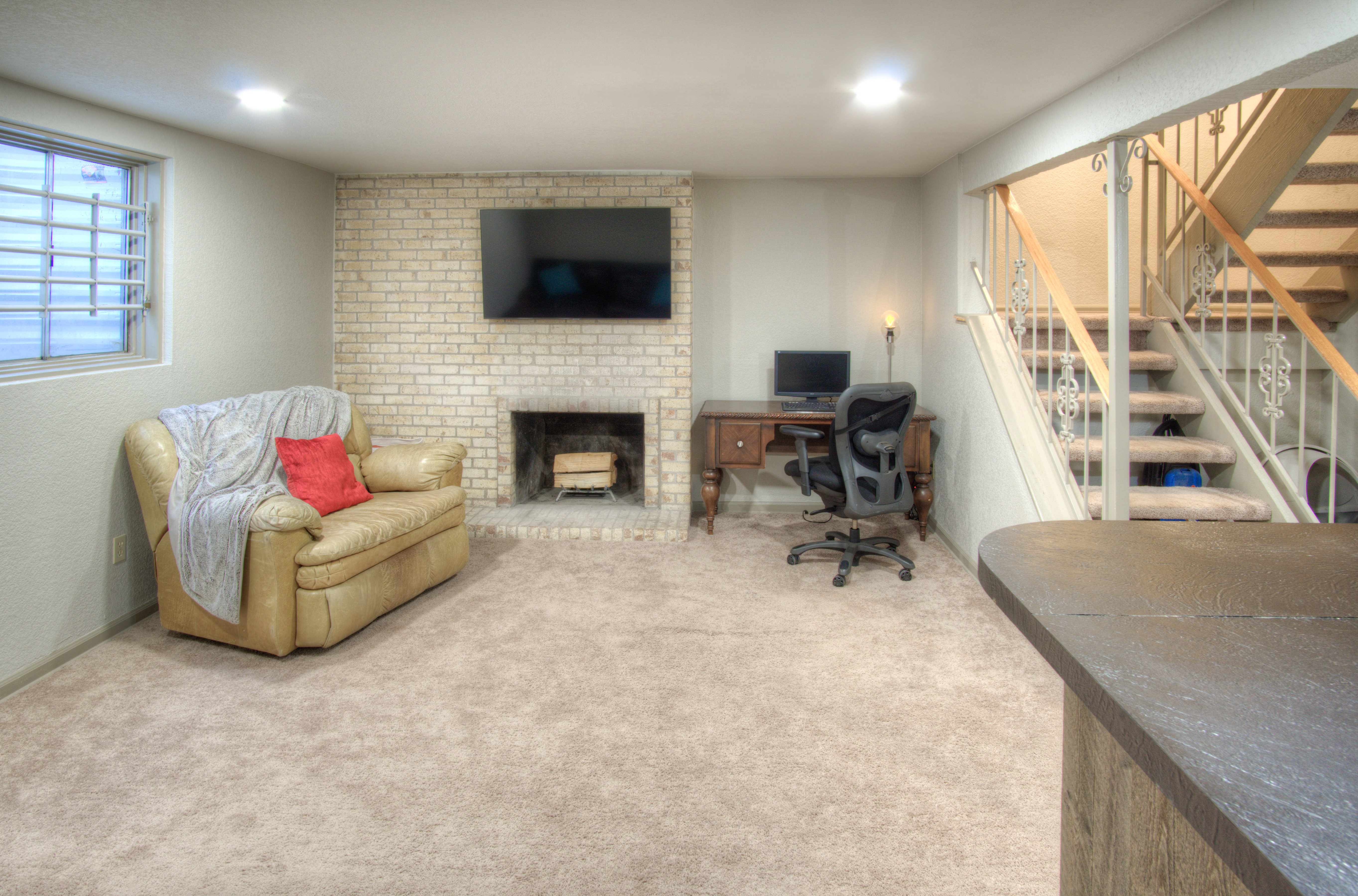 Second wood burning fireplace in bsmt living room