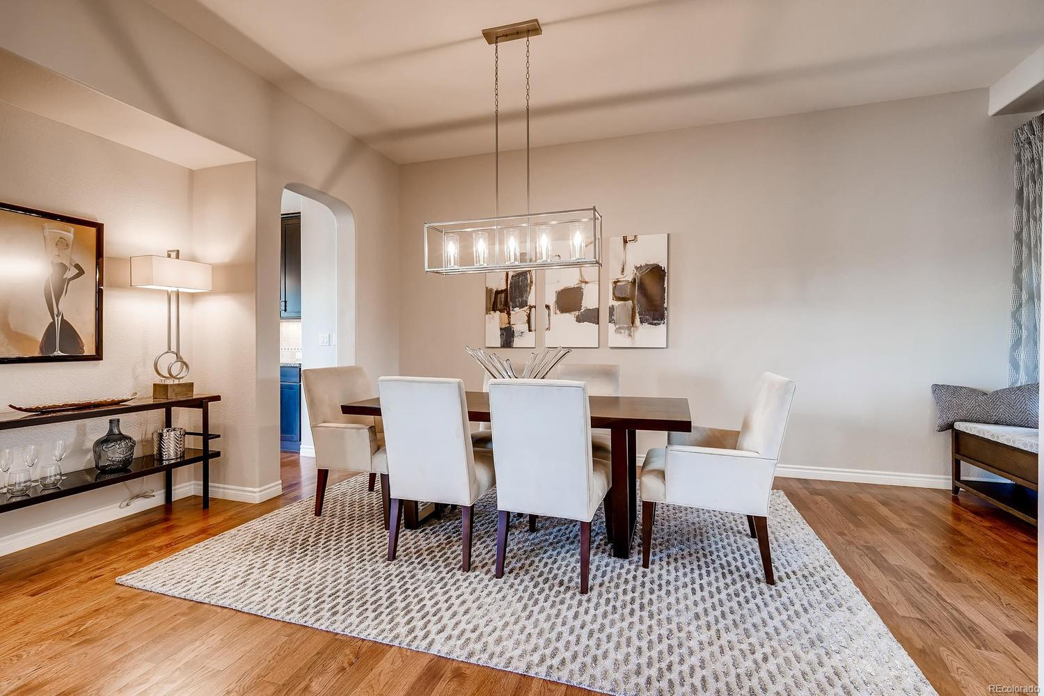 Inviting Formal Dining Space with room for a hutch/cabinet, updated lighting fin