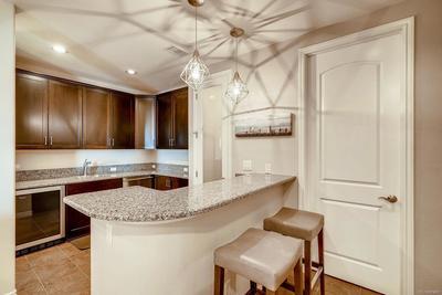 Upgraded Wet Bar equipped with wine refrigerator, sink, dishwasher, closet , sla
