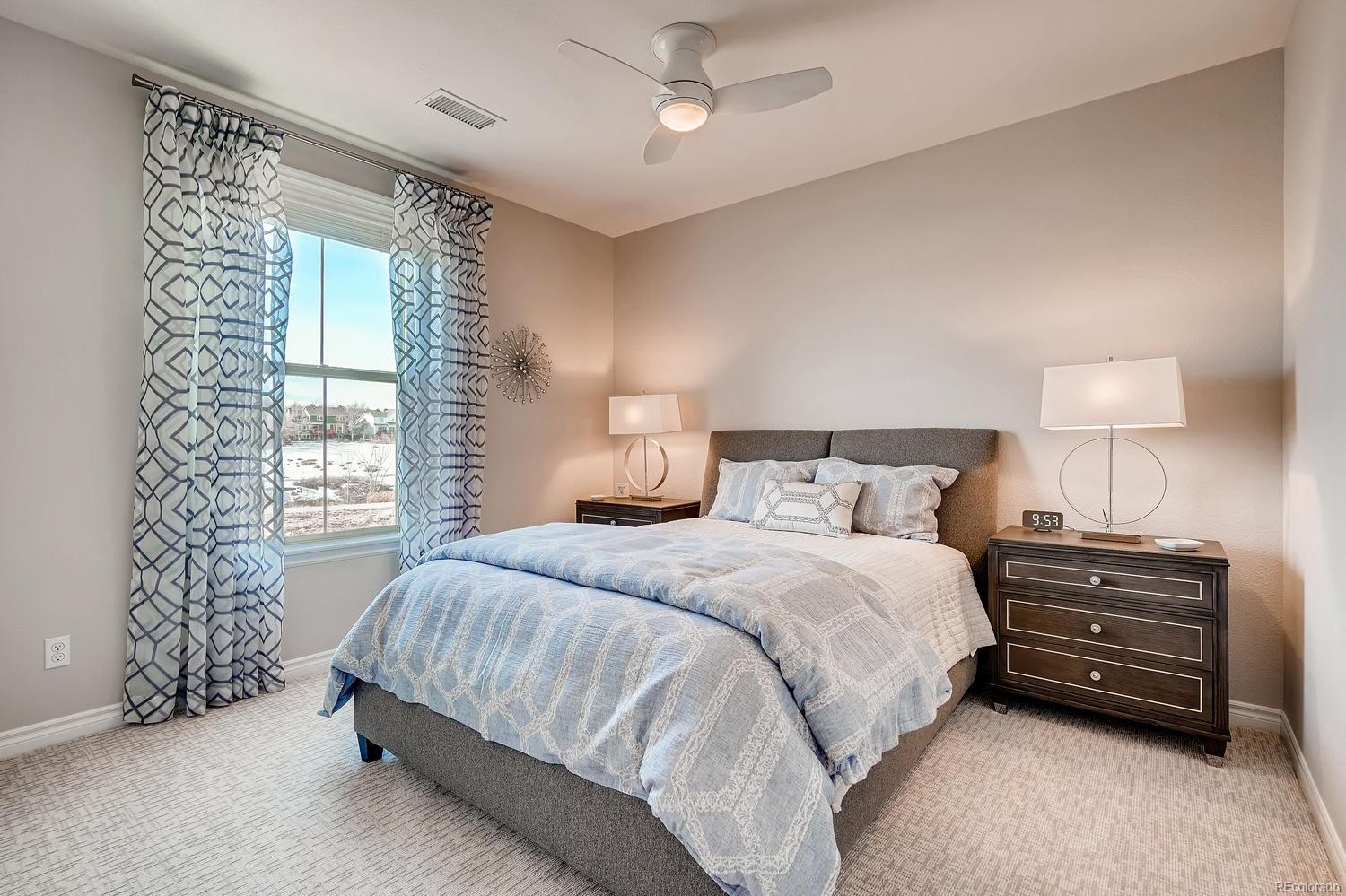 Bedroom 3 includes newer carpeting, paint, and window treatments enjoying open s