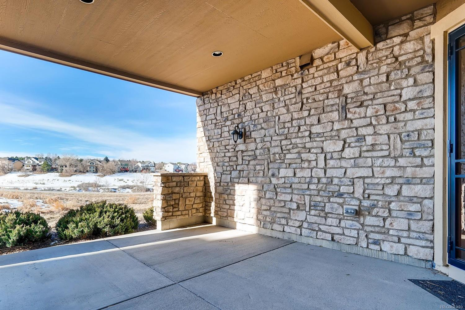 Lower Level covered patio guests and homeowners enjoy. Walking Trails just outsi