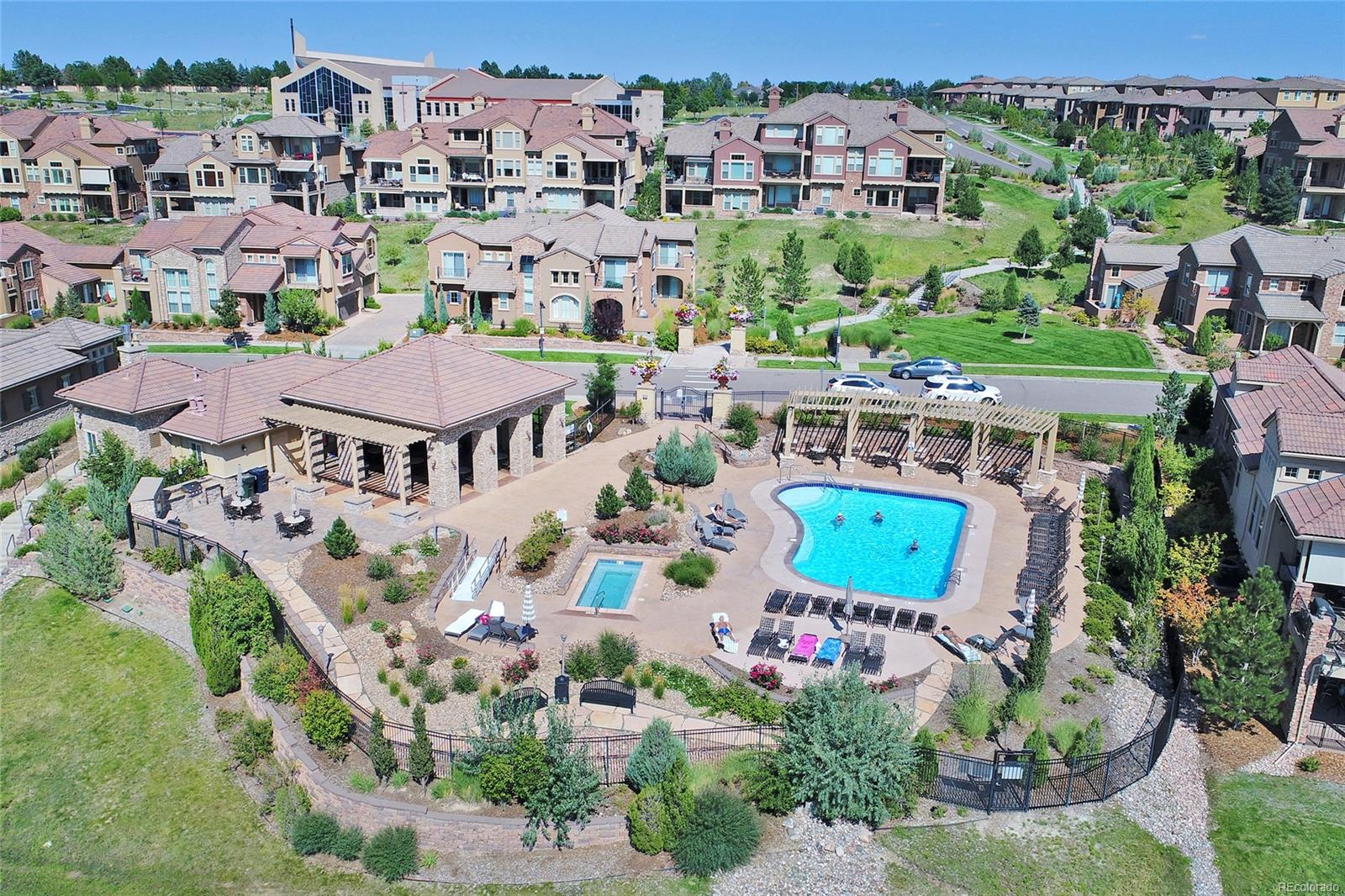 view from above the Tresana Pool, spa, outdoor grills, and covered piazza