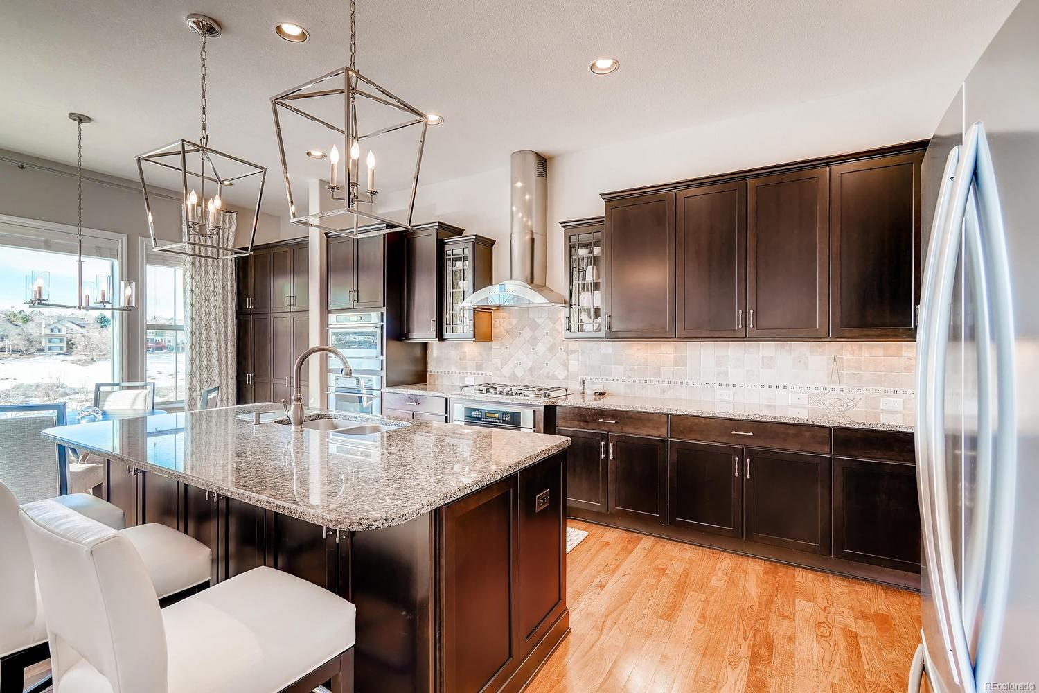 Gourmet Kitchen with Newer Updated Lighting sets off this beautiful space with O