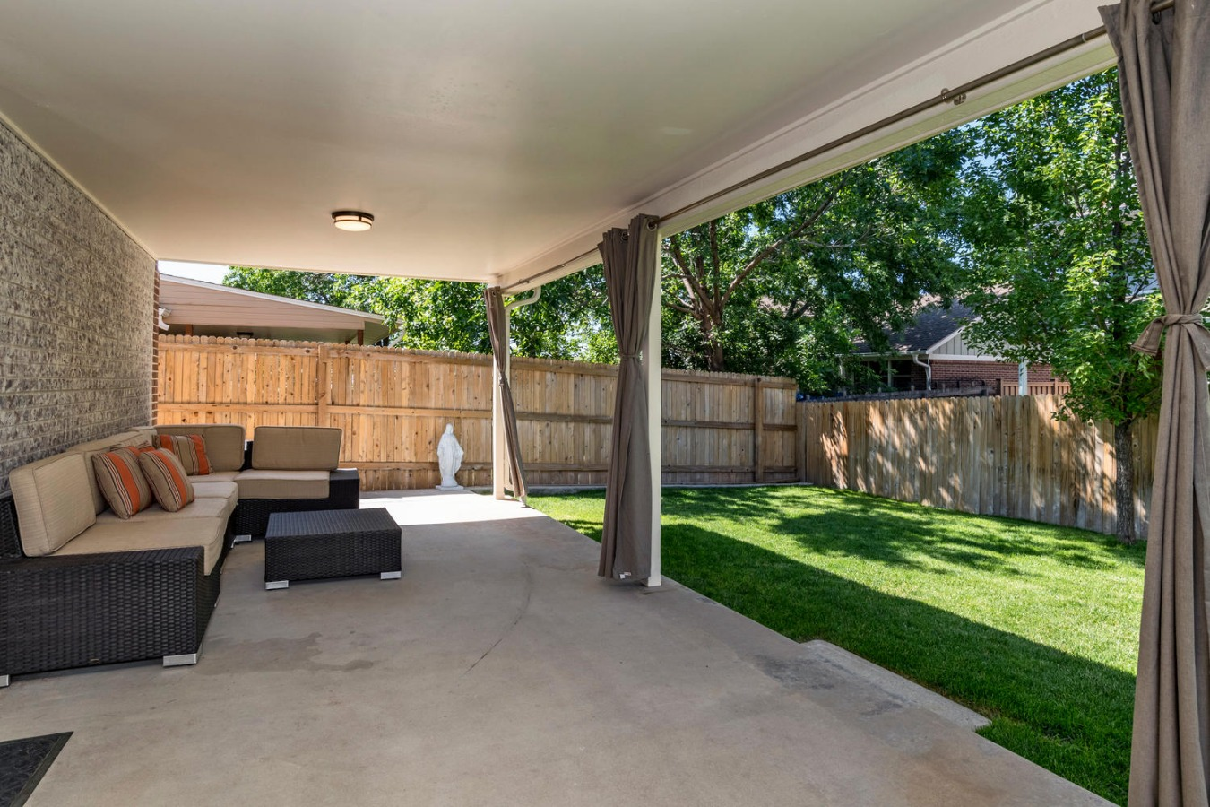 Large covered patio with recently done concrete