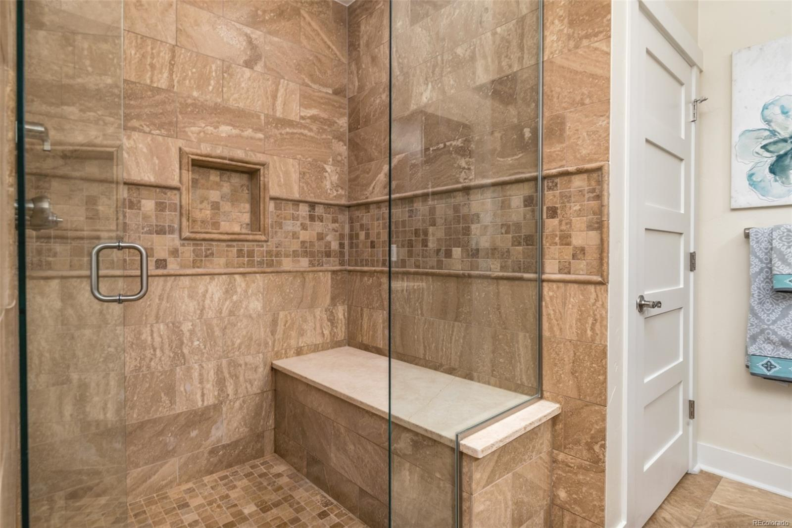 CUSTOM TILE & FRAMELESS SHOWER ENCLOSURE!