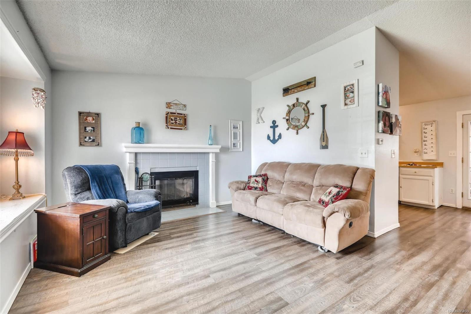 NEW LAMINATE FLOORING IN THE LIVING ROOM, KITCHEN & DINING AREA!