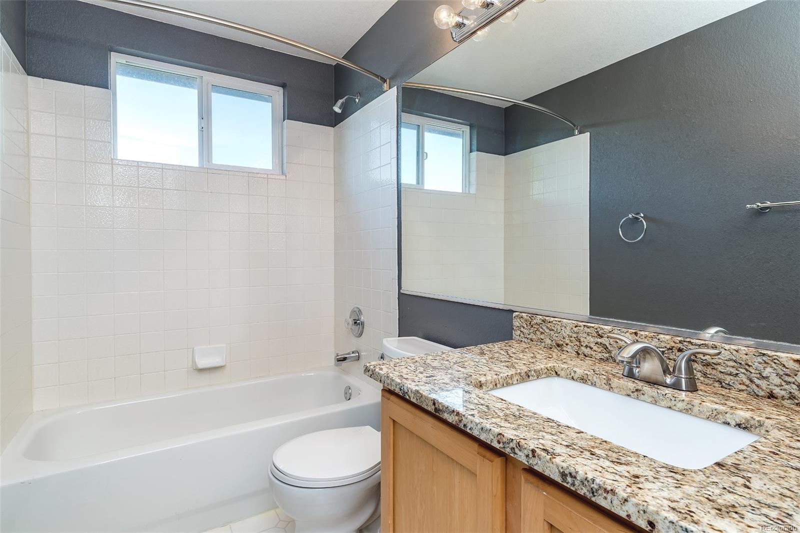 Upper level main bath w/new slab granite counter, sink & fixture!
