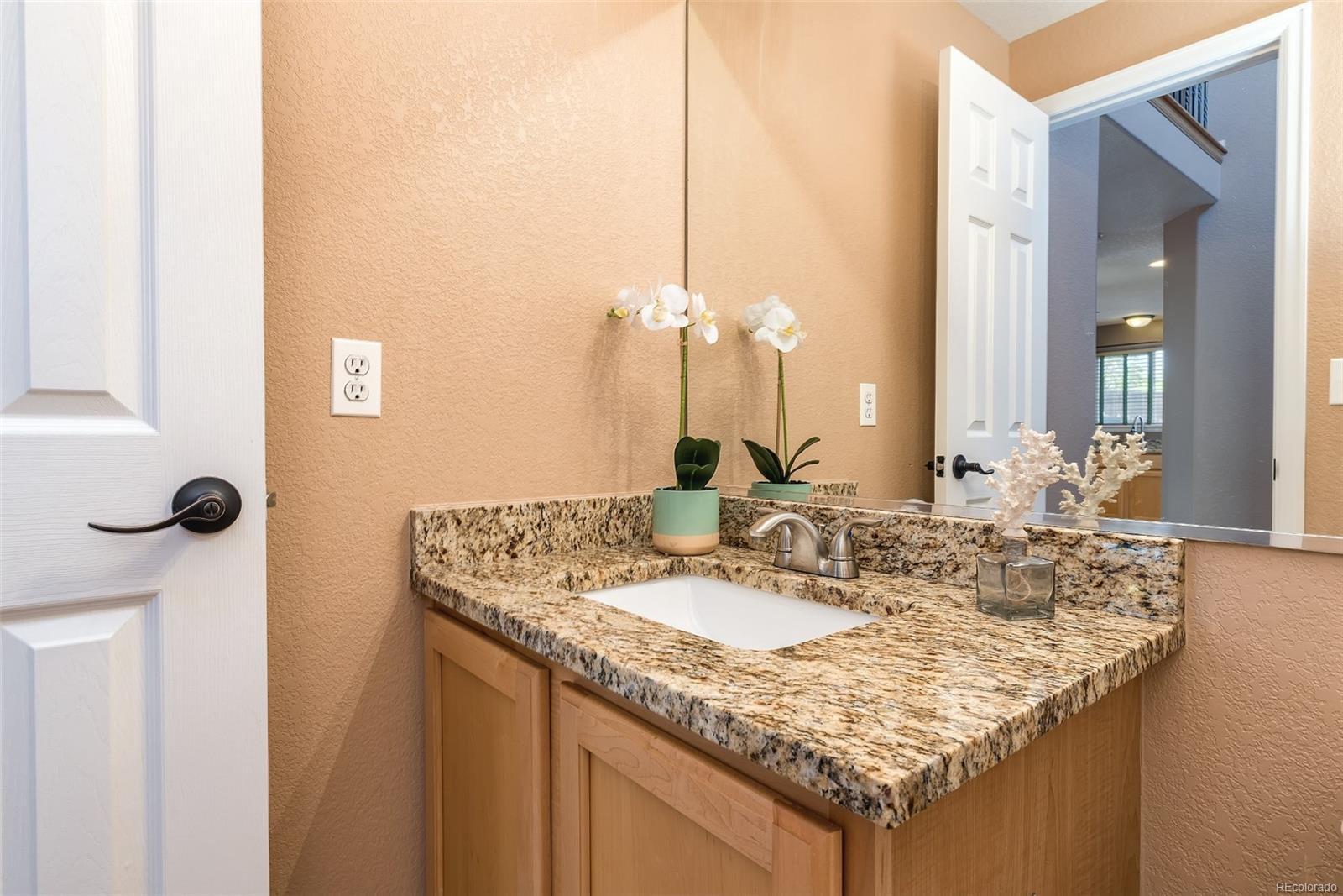 Main floor powder room with new granite counter, sink & fixture!