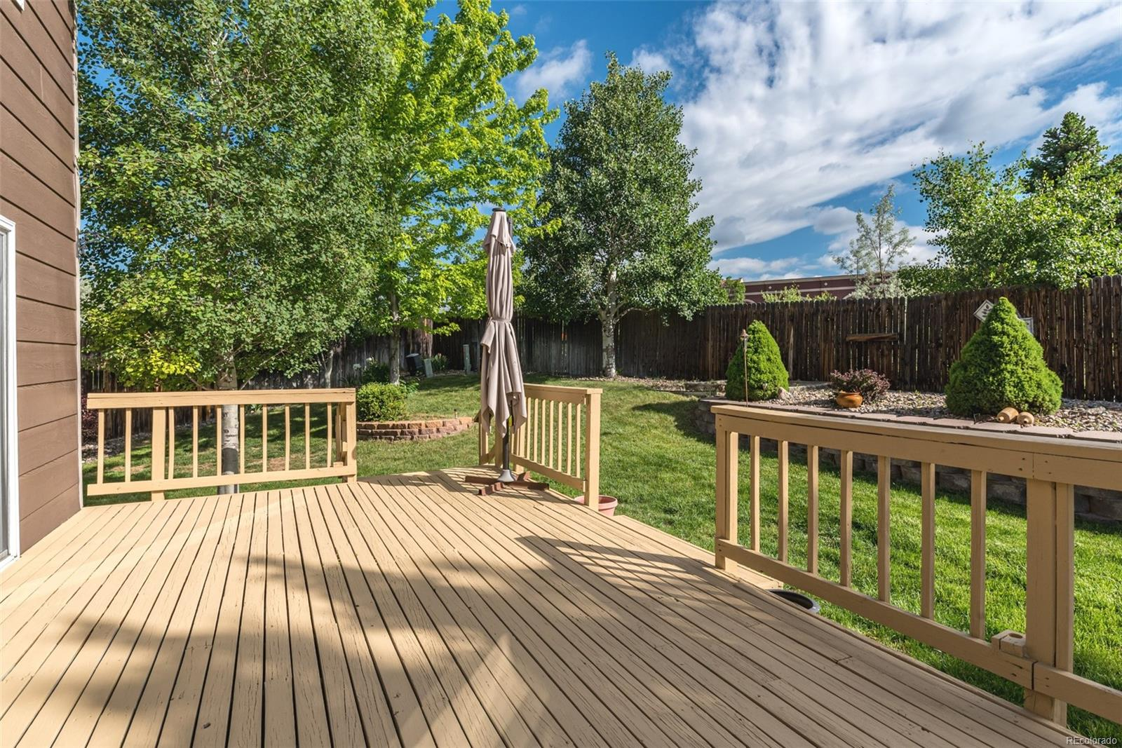 Private backyard with with sprinklers & large deck!