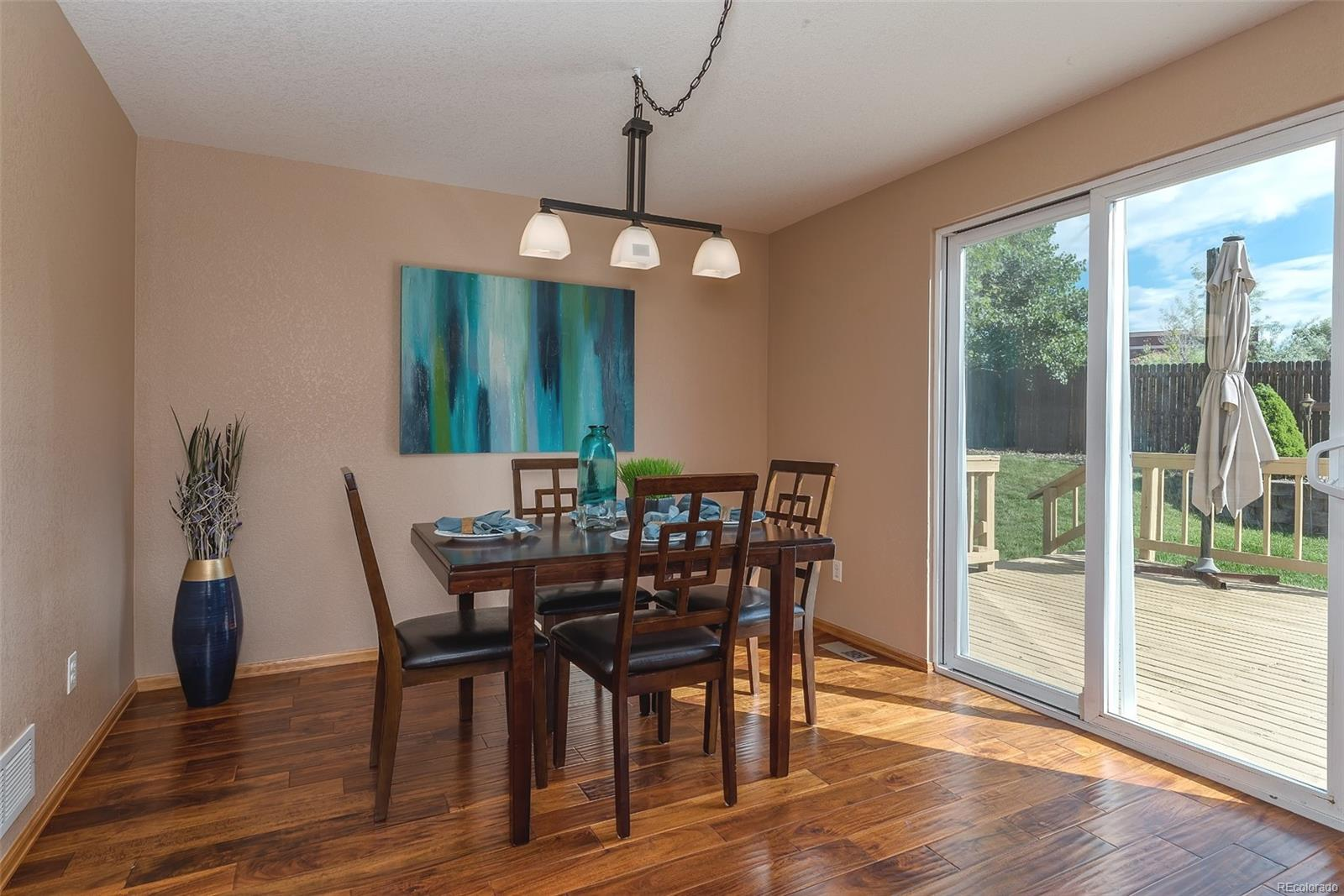 Formal dining room leading to the private backyard!