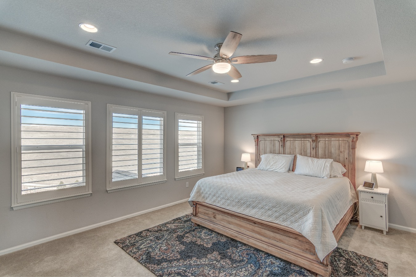 Master Bedroom with coffered ceiling & Fan