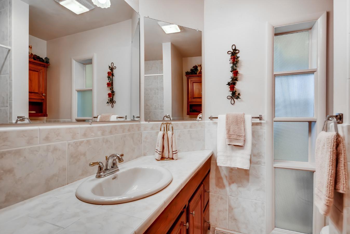 Main Bath with Spacious Vanity & Big Mirror! WOW!
