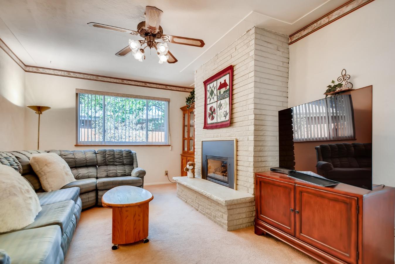 Main Floor Family Room with Fireplace & TV! Nice!