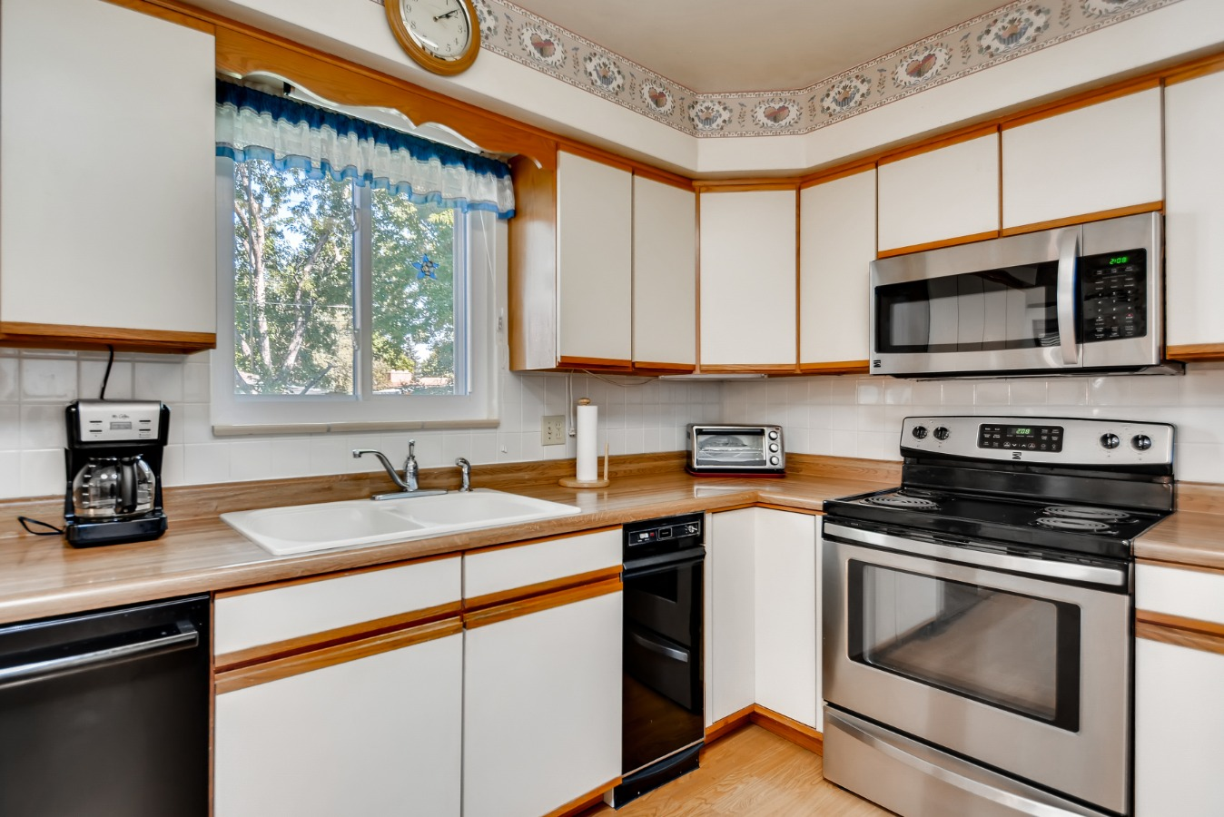 I Love it! Kitchen Sink with a backyard Window.