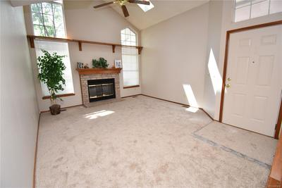 Great room has fireplace and skylights adding natural light