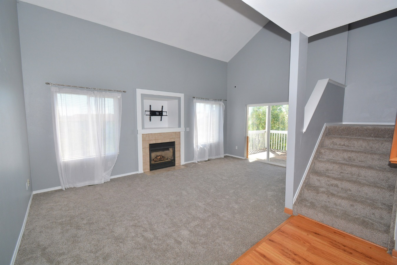 View of Living Room to Walk-Out Deck & Back Yard