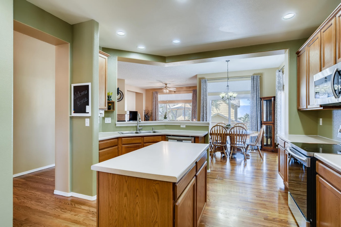 View of kitchen island and dining room area
