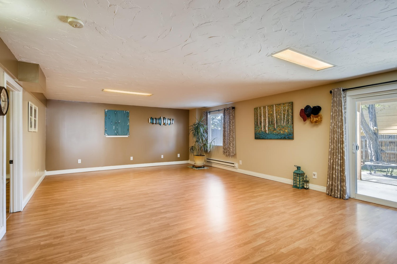 Family room in basement with walk out to patio
