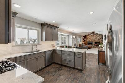 An exceptional kitchen that is all-new in the past year.  High-quality cabinets, thoughtfully-designed pull-outs, stunning tile floors will make this room the one you've dreamed of spending your time in...