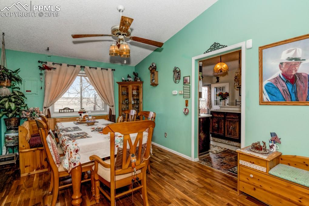 Adjoining the living room is this spacious dining area with wood flooring.