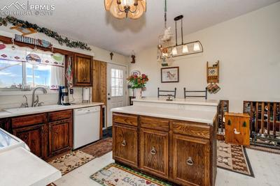 Large walk out kitchen with lots of cabinets & counter space.