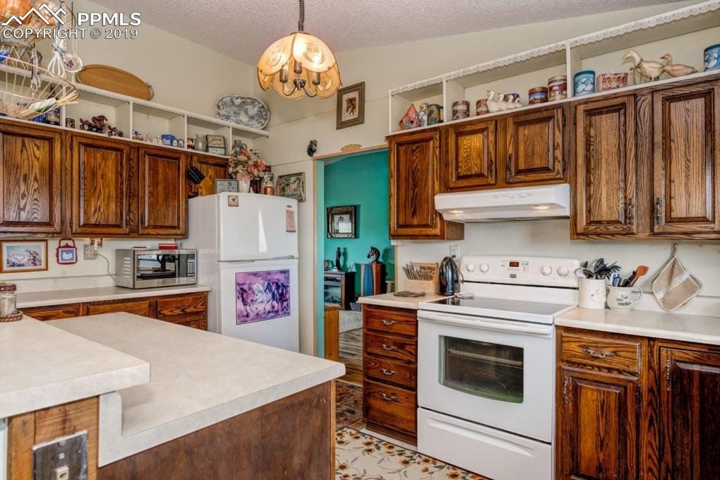 All appliances included, cozy kitchen with island