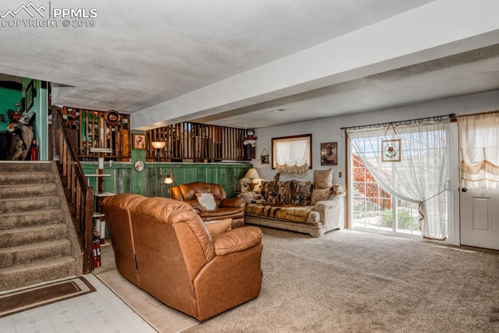 Spacious lower level family room with a private bedroom/office & full bath on this level too.