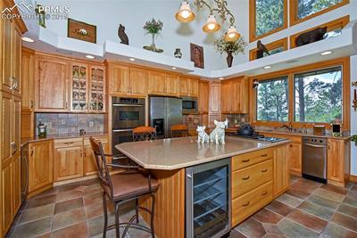 Granite Counters, Wine Cooler, Double Ovens