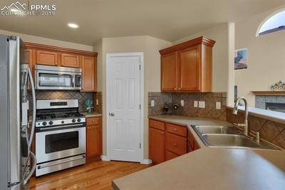 Good sized kitchen with pantry and stainless steel appliances