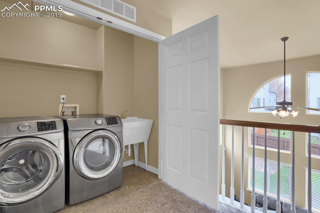 Upper level laundry with utility sink