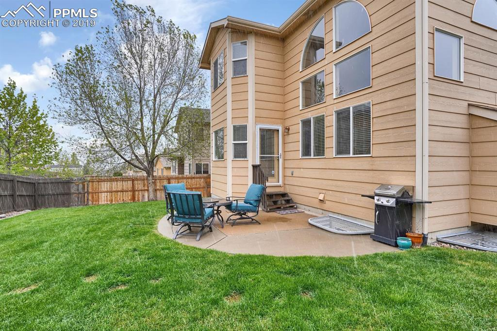 Fully fenced yard with patio