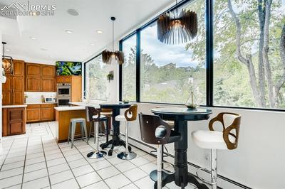 The breakfast bar and nook are overlooked by more massive new windows to take advantage of the views!