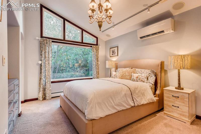 This is one end of the massive master suite with unique architectural details.