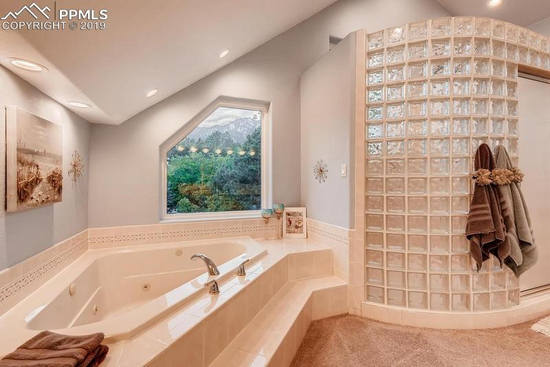 Jetted tub mountain views and huge shower for a spa-like feel.