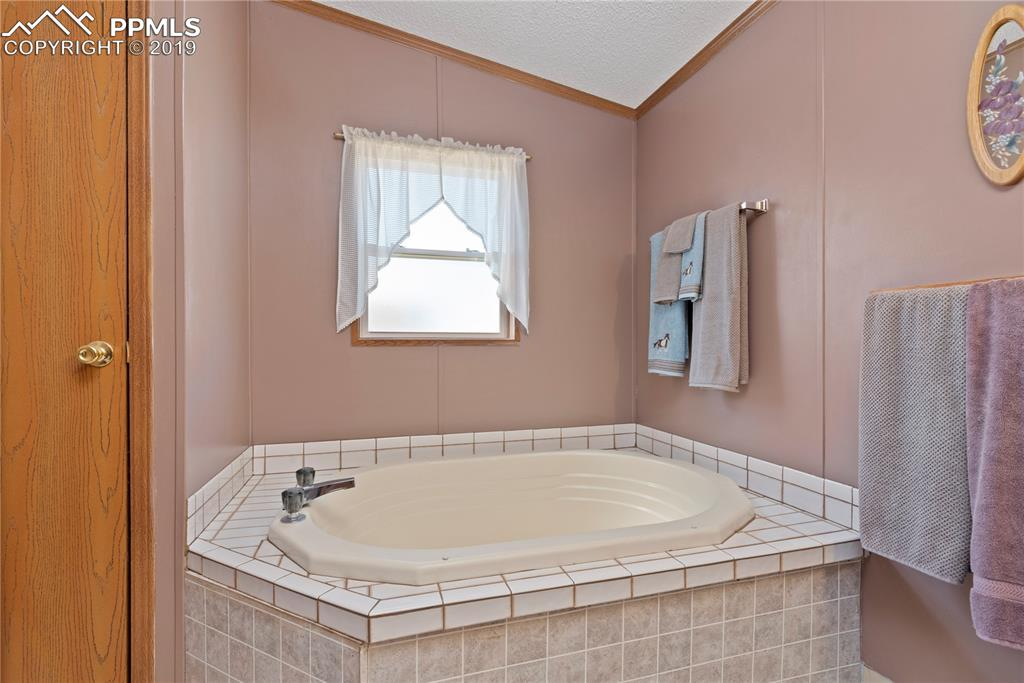 Enjoy a good soak in the large tub.