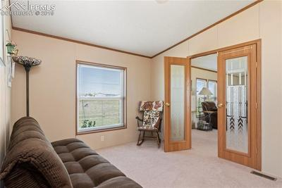 Third bedroom/office has lovely French Doors.