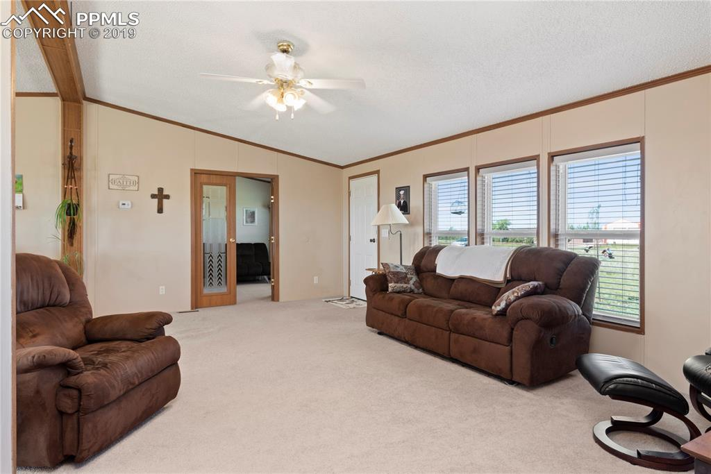 Large living area showing French doors to office/3rd bedroom.