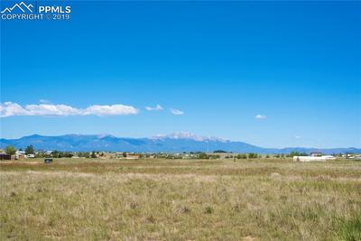 Spectacular Pikes Peak and Front Range views from the front of the home, master bedroom, third bedroom and living room.