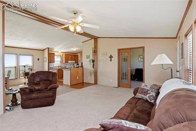 The living room is wide open to the huge dining room and part of the kitchen.