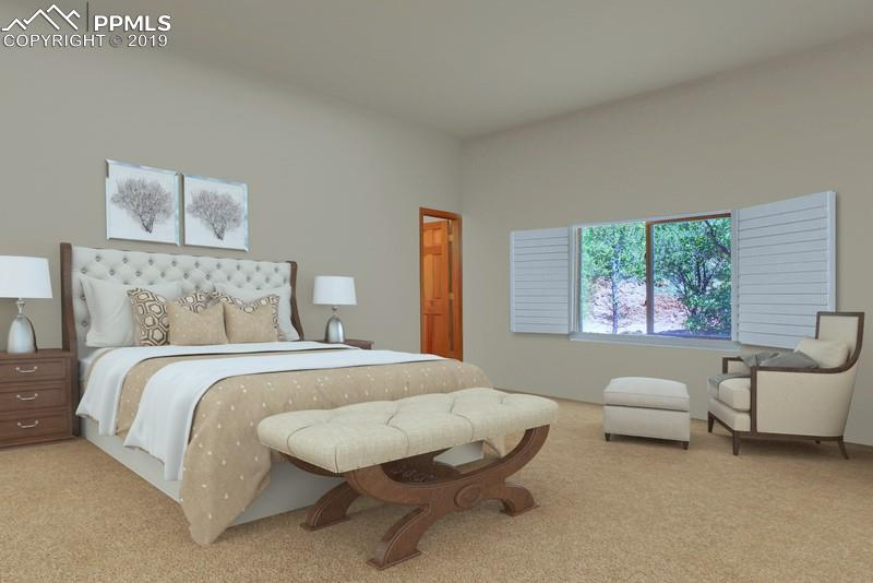 Notice the door to the left of the bed-it is currently a walk-in closet, but has a rough for a second master bath.
