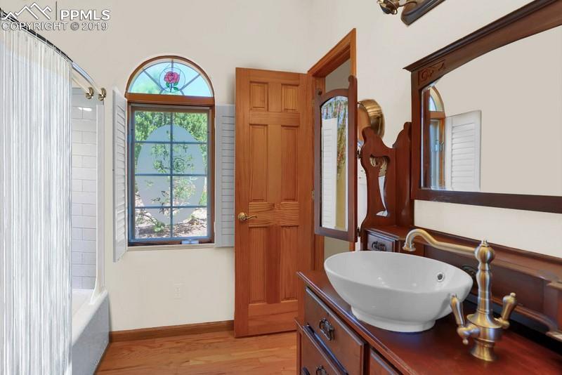 Master bath.  Note the charming antique vanity/vessel sink.