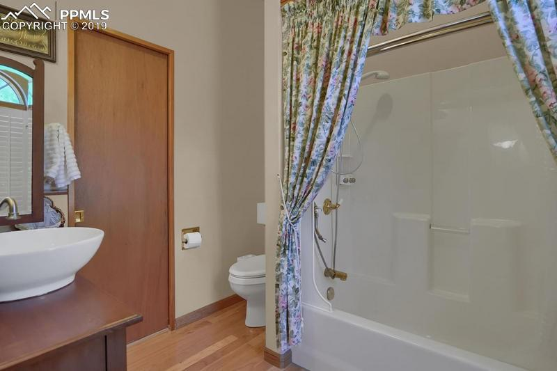 The huge laundry room has lots of extra storage, built-in ironing board, a half bath, and mountain views!