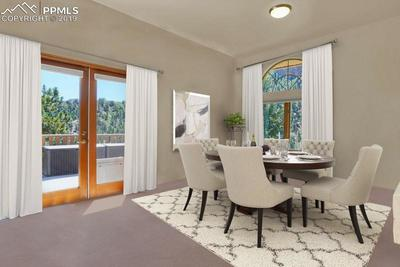 This shot shows the view out the french doors to the composite deck with massive city views.
