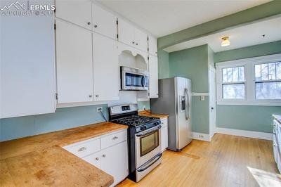 Kitchen features expansive counter tops, tons of storage, a gas range and stainl