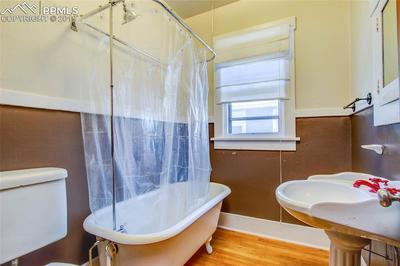 Main level bath with original claw foot tub.