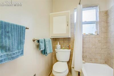 Full bath with tile floors and walls.