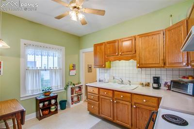 Kitchen features oak cabinets with some pull outs.