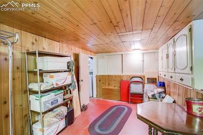Basement space contains built-ins, window and plenty of storage space.