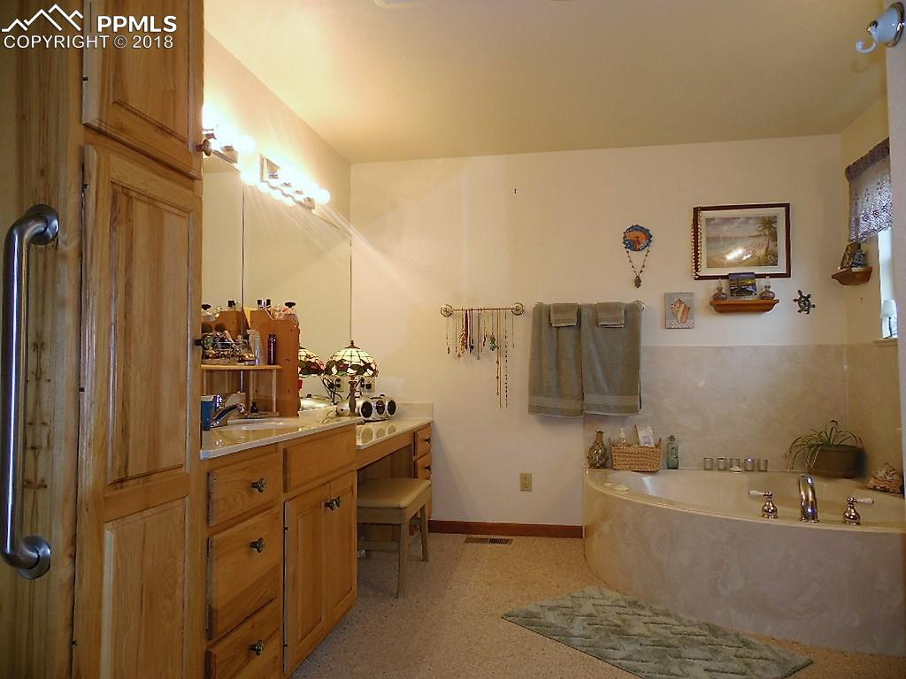 Relax In The Jetted Tub! Extended Vanity with Bench Included
