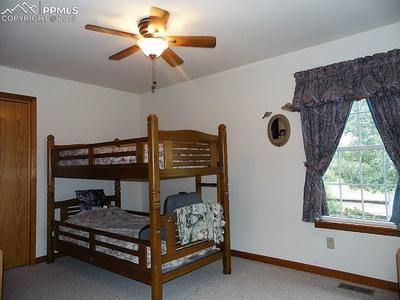 Secondary Bedroom with Treed Views